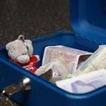 Tatty in the money box